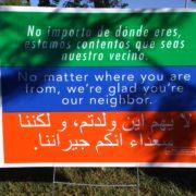 welcome neighbor sign